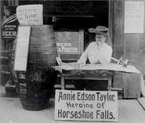 Annie Edson Taylor signs autograhs in 1901