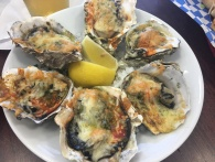 Baked oysters with pesto, parm and hot sauce - The Fish Peddler, Tillamook, OR
